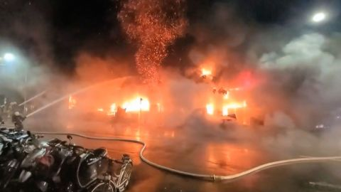 In this image taken from video by Taiwan's EBC, firefighters battle a blaze at a building in Kaohsiung, in southern Taiwan on Thursday, Oct. 14, 2021. A fire engulfed a 13-story building overnight in southern Taiwan, the island's semi-official Central News Agency reported Thursday. (EBC via AP )