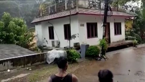 A screengrab from footage that shows a house being washed away by floods in India. At least 27 people have been killed after heavy rain triggered floods and landslides in southern Indian state of Kerala.