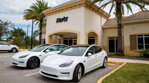 Tesla Model 3 electric vehicles at a Hertz location.