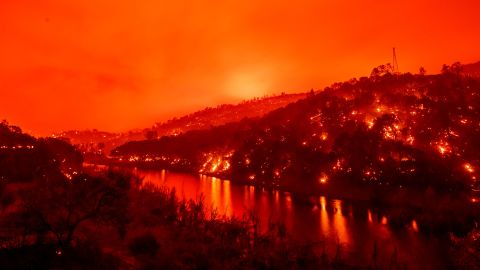 Flames are seen on both sides of Lake Berryessa in this long-exposure photo taken in Napa, California, on Tuesday.